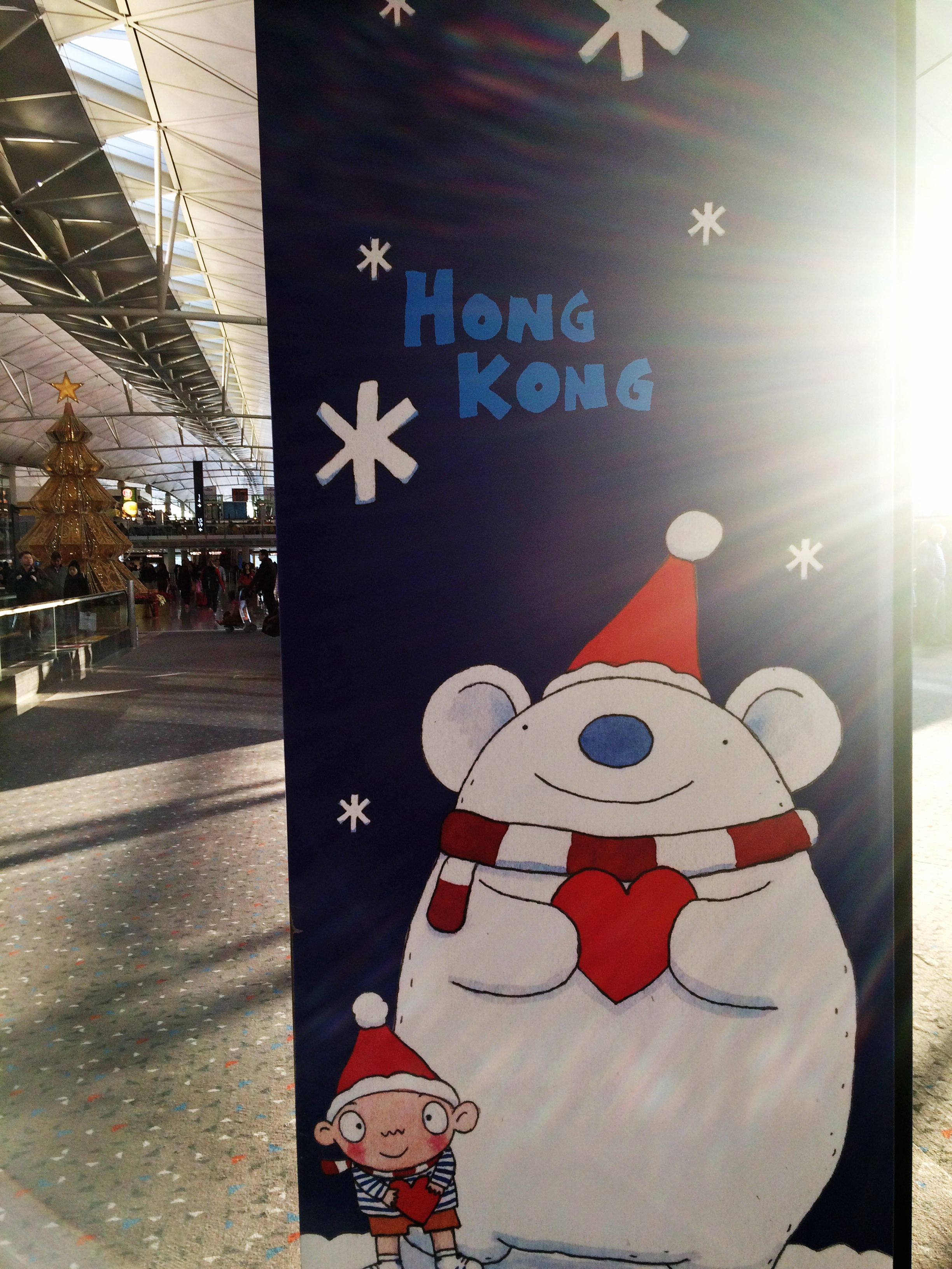 The gate signs at the airport in Hong Kong were festive and adorable.