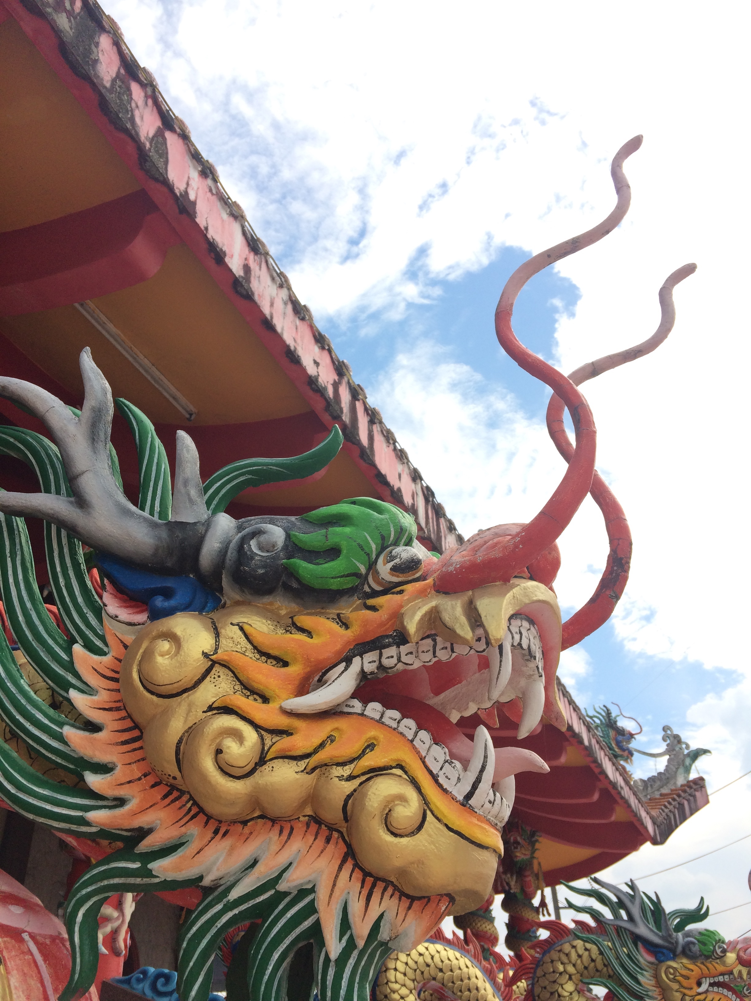 The Chinese temple was much more decorated and ostentatious than the Thai temple.