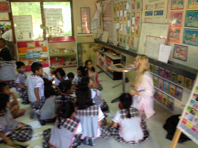 This is me with my kindergarten class learning about animals!